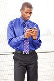 Black businessman texting — Stock Photo