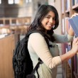 Stock Photo: Asian student in library