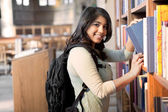 Asian student in library — Stock Photo