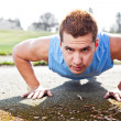 Mixed race man doing push up — Stock Photo