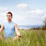 Mixed race man practicing yoga — Stock Photo