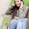 Ethnic student on the phone — Stock Photo