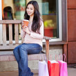 Shopping woman drinking coffee — Stock Photo