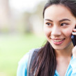Asian student on the phone — Stock Photo