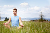 Mixed race man practicing yoga — Stock Photo
