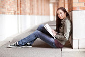 Ethnic college student studying — Stock Photo