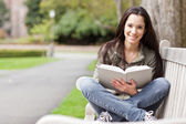 Ethnic college student studying — Stockfoto