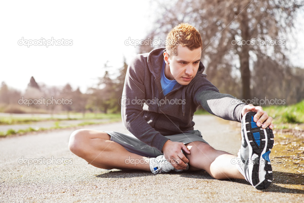 A shot of a mixed race man stretching outdoor — Stock Photo #6264713