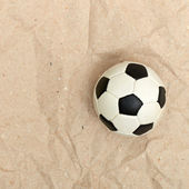 Football ball on old paper — Stock fotografie