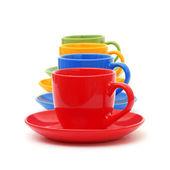 Multicolored ceramic mugs over white — Stock Photo
