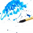 Brush with blue paint stroke and stick - Stock Photo
