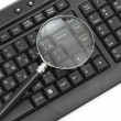 Magnifying glass, concept of on line security - Stock Photo