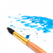 Brush with blue paint stroke and stick — Stock Photo