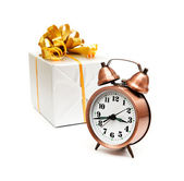 A retro clock with presents — 图库照片
