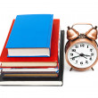 Foto Stock: Clock and books
