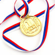 Golden medal and ribbon - Stock Photo