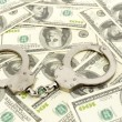 Handcuffs on money background — Stock Photo #6466715