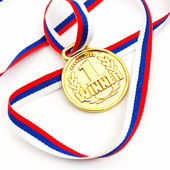 Golden medal and ribbon — Stock Photo