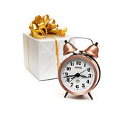 A retro clock with presents — Zdjęcie stockowe