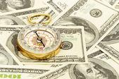 Compass on money — Stock Photo