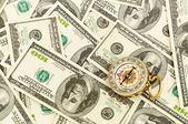 Compass on money background — Stock Photo