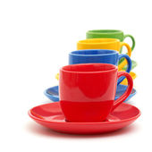 Beautiful color cups on a white — Stock Photo