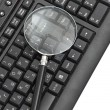 Magnifying glass, concept of on line security — Stock Photo