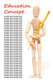 Wooden puppet holding pencil — Stock Photo