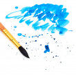 Brush with blue paint stroke and stick — Stock Photo #6663265