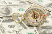 Dollars and compass — Stock Photo