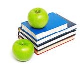 Books and an apple — Stockfoto