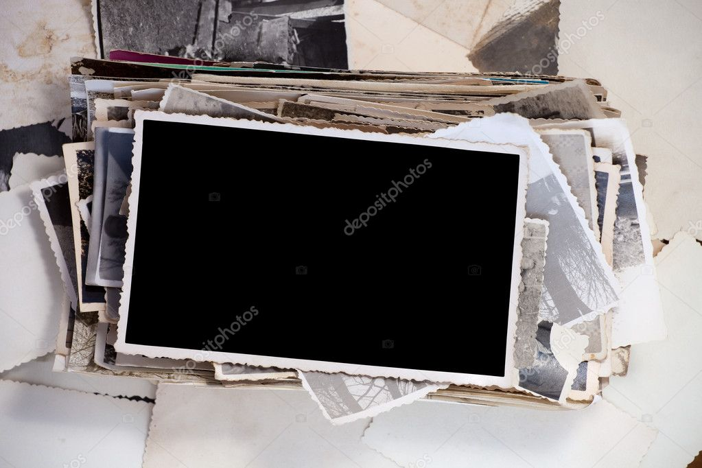 Stack of old photos with one blank photo for your image. — Stock Photo #6713691