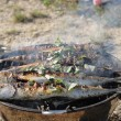 Stock Photo: Preparing grilled fishes