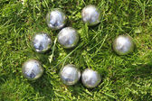 Petanque bowls in the green grass — Stock Photo