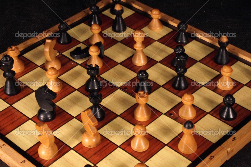 Detail of the set of chess on the black background — Stock Photo #6114974