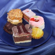 Selection of sweet deserts on the plate — Stock Photo