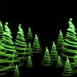 Christmas forest from the color lights — Stock Photo #6233131
