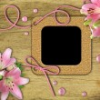 Vintage photo frames and pink lily — Stock Photo #5912781