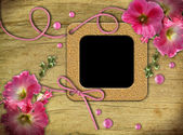 Vintage photo frames and pink mallow — Stock Photo