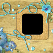 Vintage photo frames and blue mallow flowers - Foto Stock