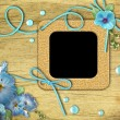 Vintage photo frames and blue mallow flowers - Stockfoto