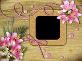 Vintage photo frames and pink lily — Stock Photo