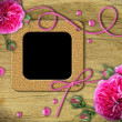 Vintage photo frames and roses — Stock Photo