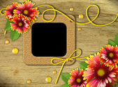 Vintage photo frames and red and yellow daisies — Stock Photo