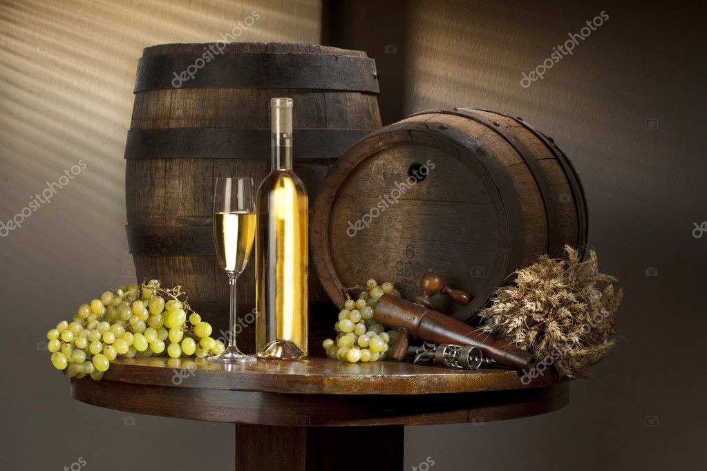 Still life with white wine on old table and barrel — Stock Photo #6498136