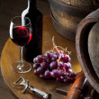 Stock Photo: Red wine on old table