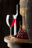 Still life with red wine on table — Stock Photo