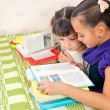 Stock Photo: Two girls read books