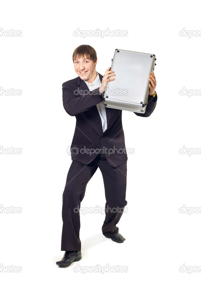 A man with a briefcase in his hands standing on a white background — Stock Photo #5495045