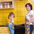 Stock Photo: Mother and daughter in kitchen